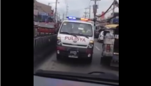 Police Car counter-flowing in a busy highway